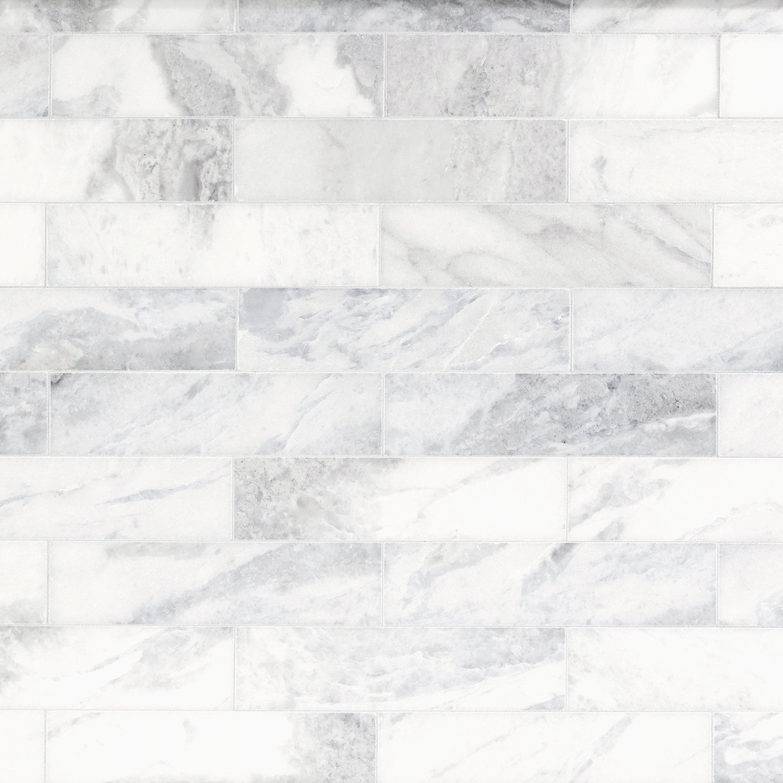 Carrara marble tile herringbone carrara nero marquina for Carrara marble per square foot